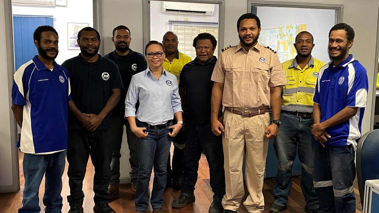 Photo: Chief Mate Craig Selan (third from right), Crewing Manager Nannette Camba (third from left) and the Lae crewing team share a group photo.